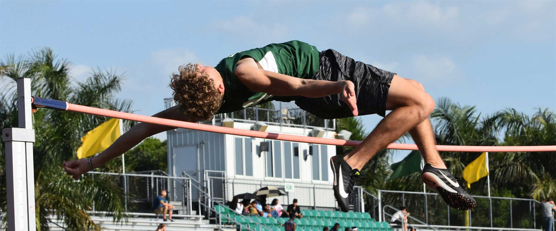 Student leaping over a high jump