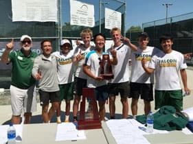 Tennis team holding trophy
